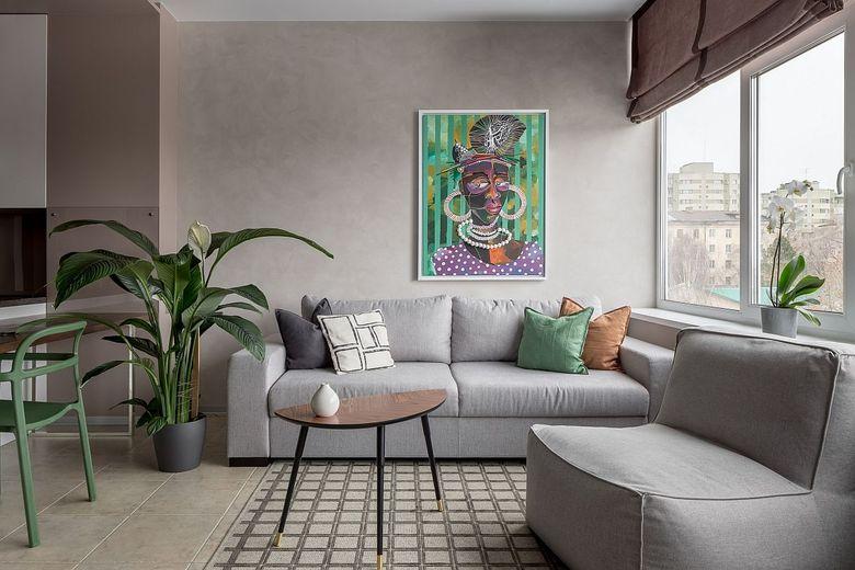 Диваны для гостиной акцентные подушки и настенные рисунки