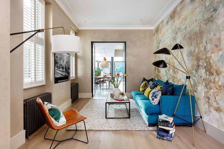 Цвет стен в гостиной текстурированный и уникальный